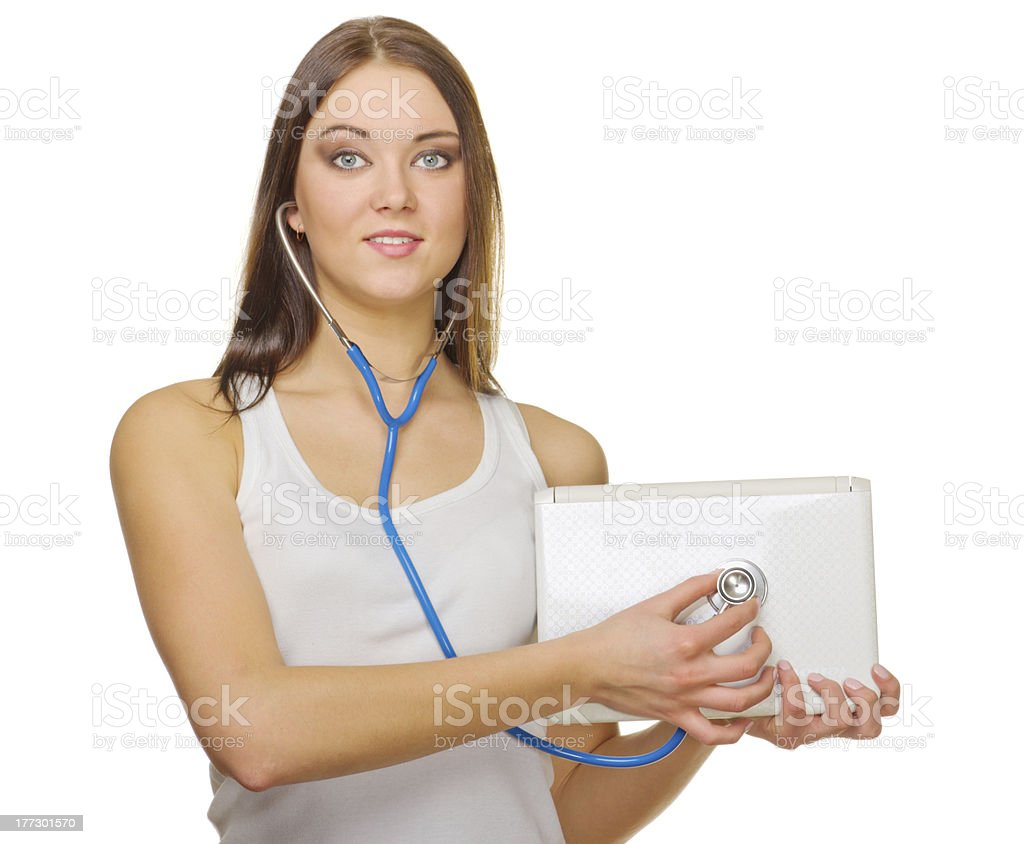 Young smiling girl with laptop and stethoscope royalty-free stock photo