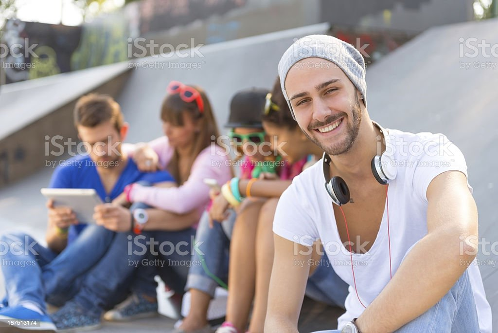 Young smiling guy in the skate park royalty-free stock photo