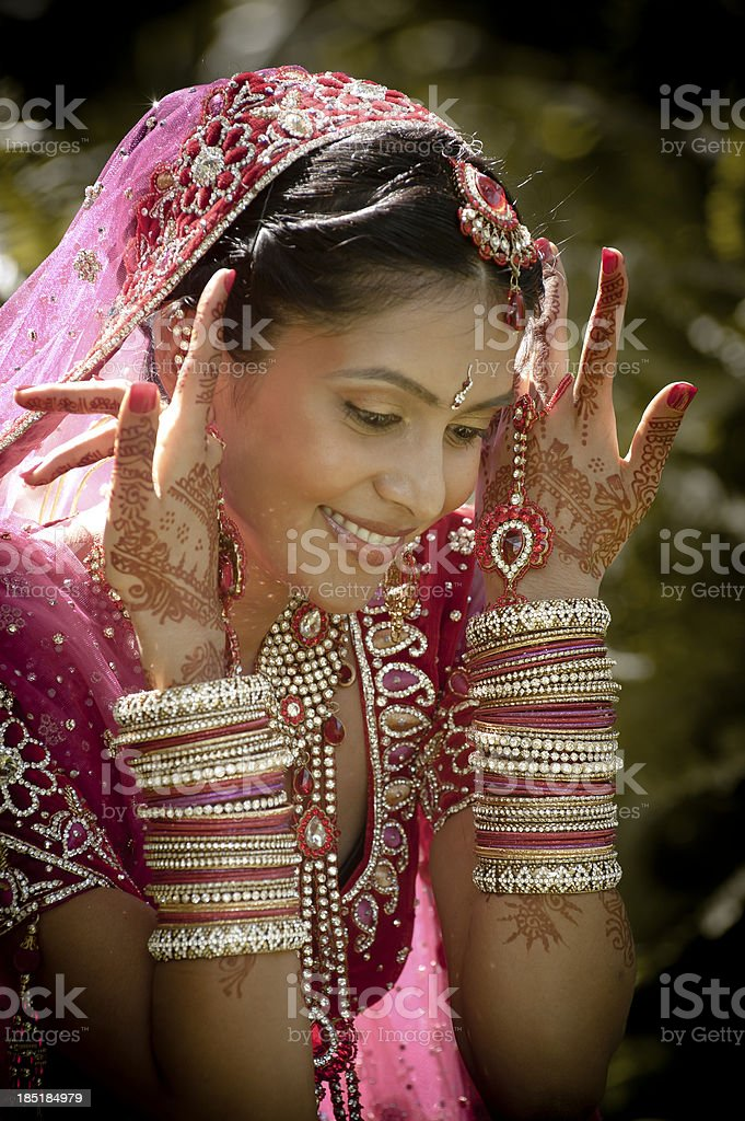Young smiling indian bride wearing traditional dress stock photo