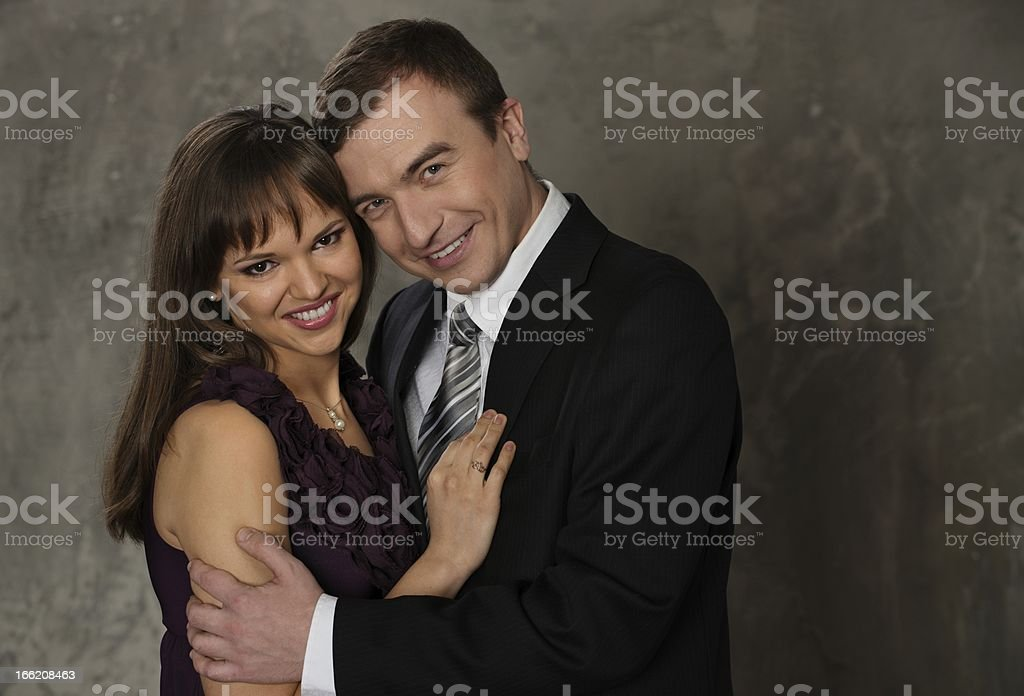 Young smiling man and woman in elegant evening dress royalty-free stock photo