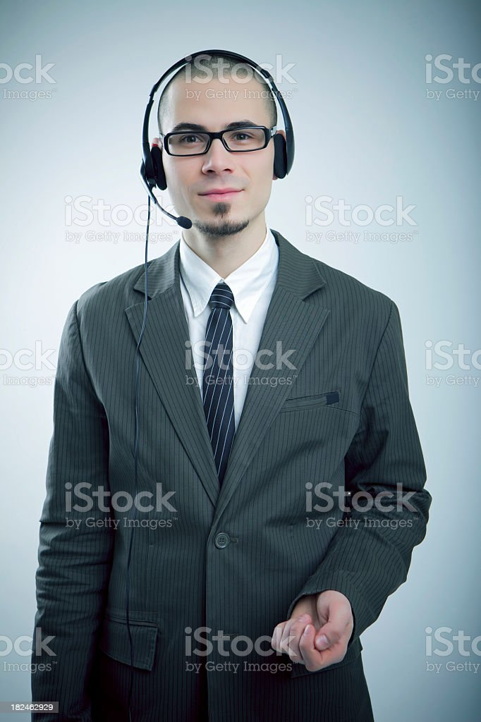 Young smiling man with a headset royalty-free stock photo
