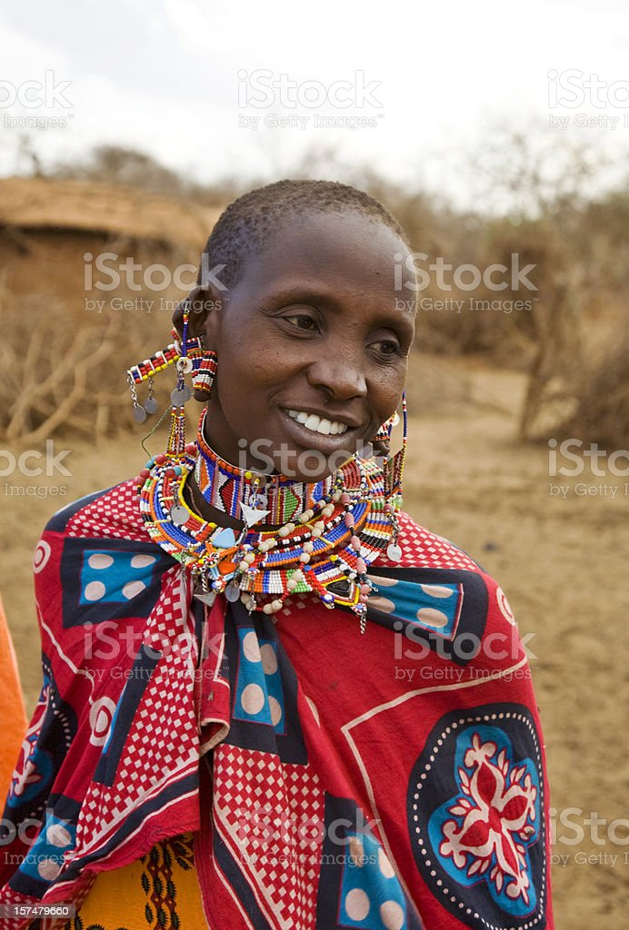 Young smiling Masai woman in front of her village, Kenya. stock photo