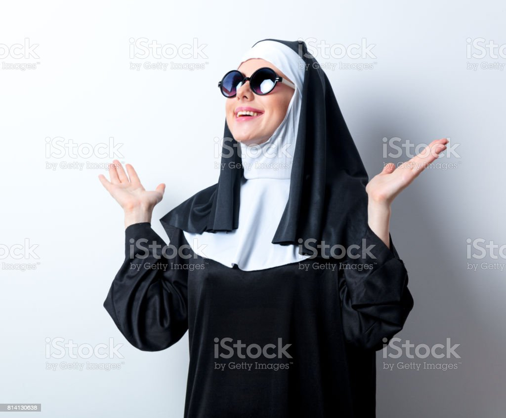Young smiling nun with sunglasses stock photo