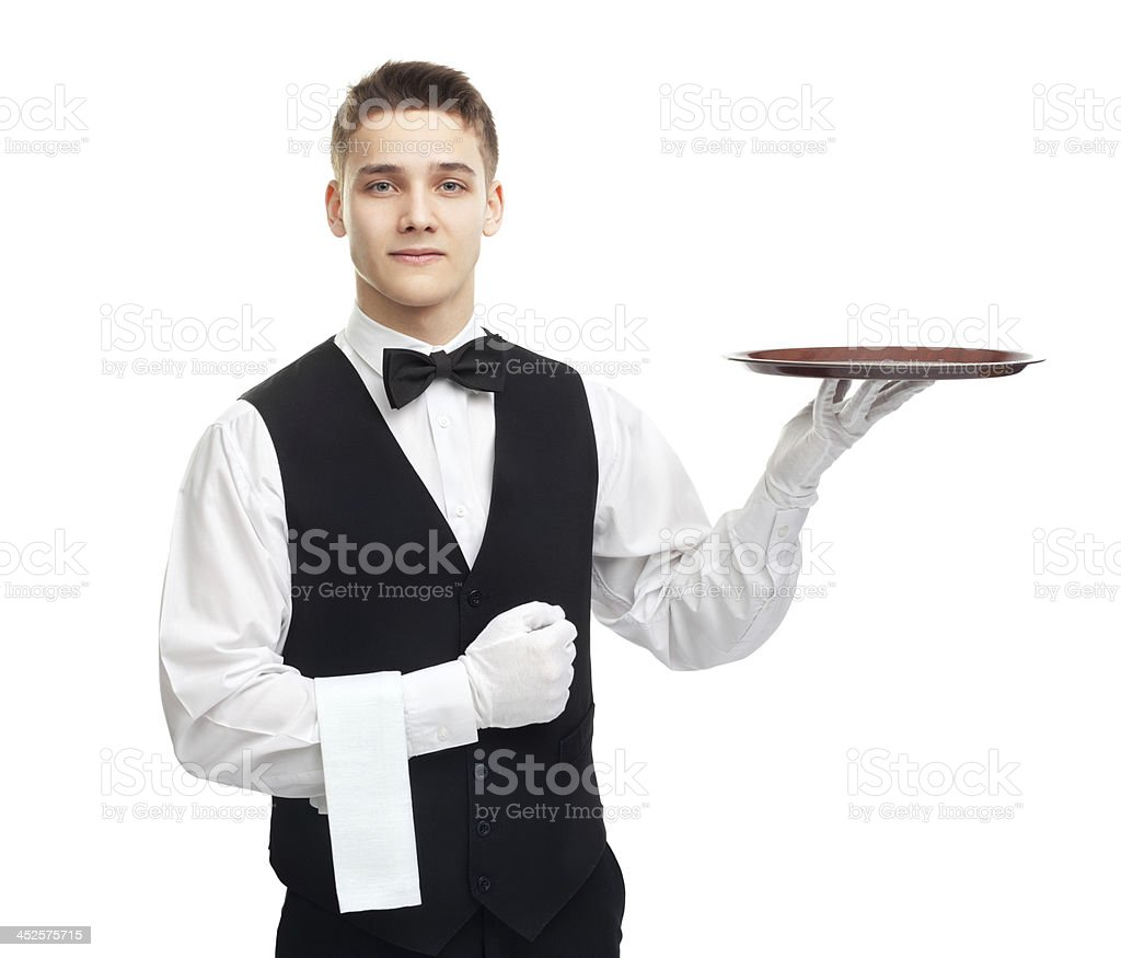 Young smiling waiter with empty tray stock photo