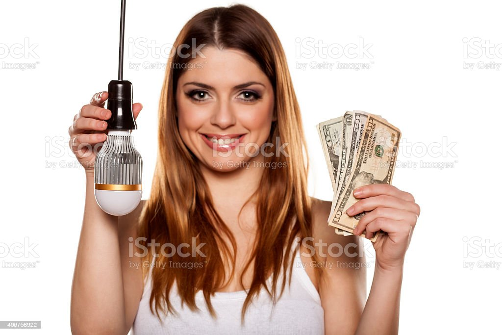Young smiling woman advertising new LED Technology stock photo