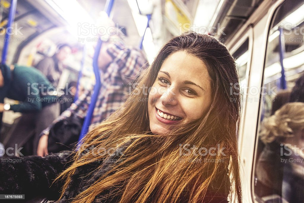 Young smiling woman commuting stock photo