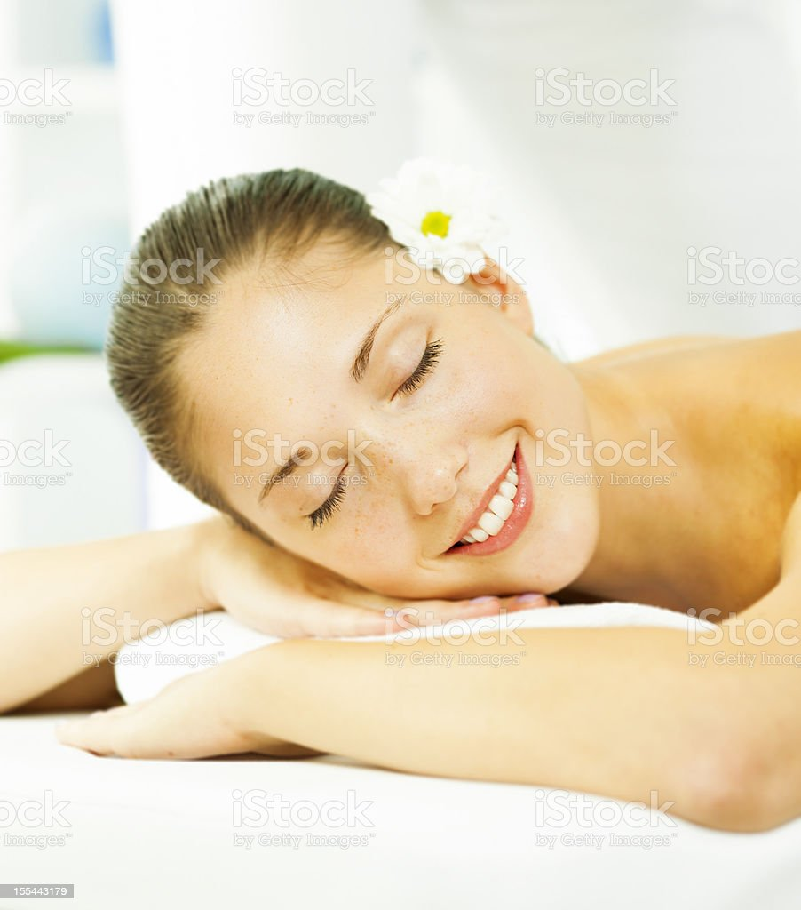 Young smiling woman enjoy back massage. royalty-free stock photo