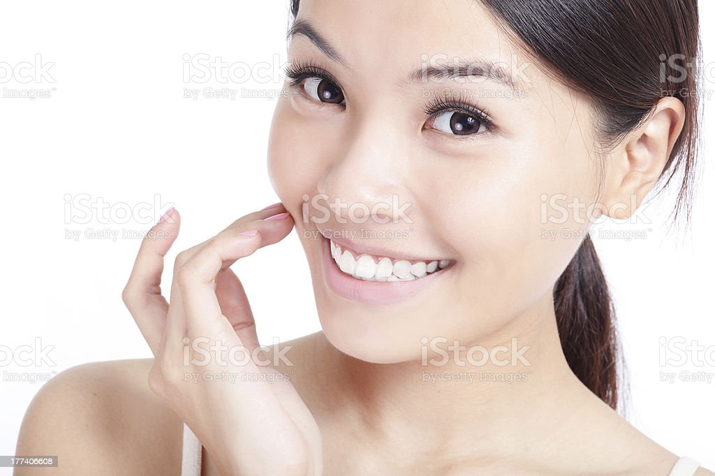 young smiling woman hand touch her mouth stock photo