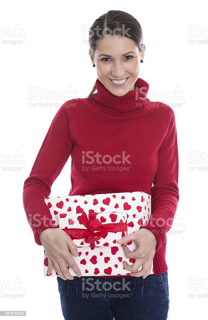 Young smiling woman holding a gift for valentine or christmas. royalty-free stock photo
