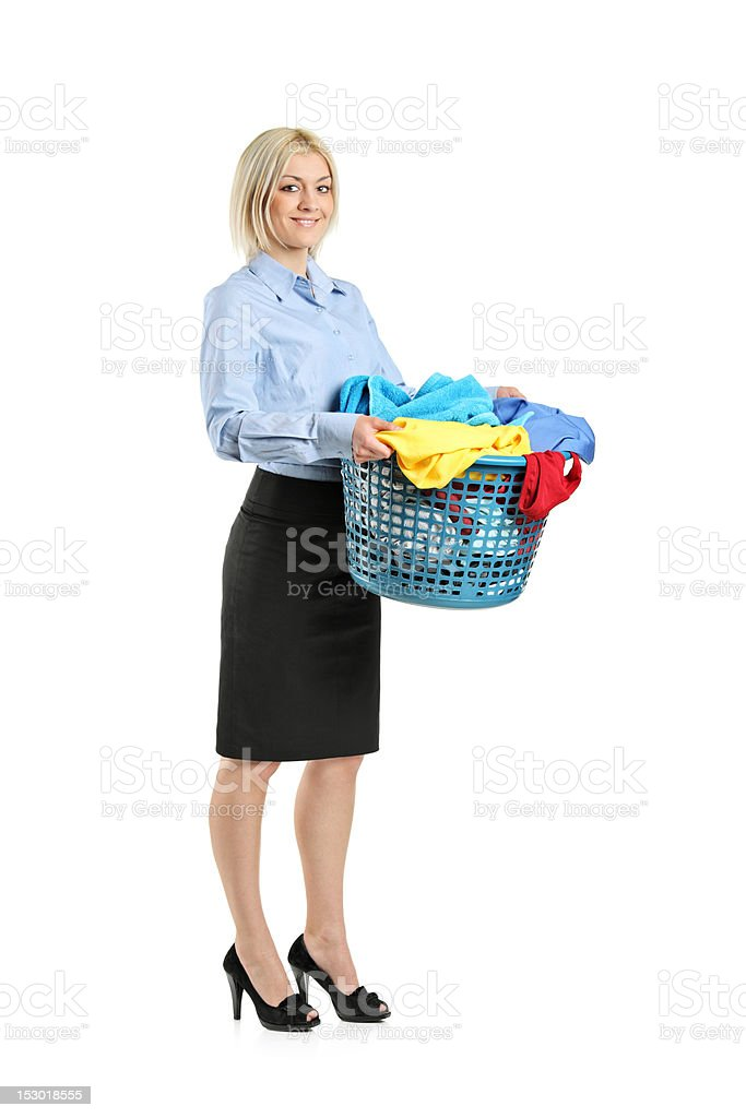 Young smiling woman holding a laundry basket royalty-free stock photo