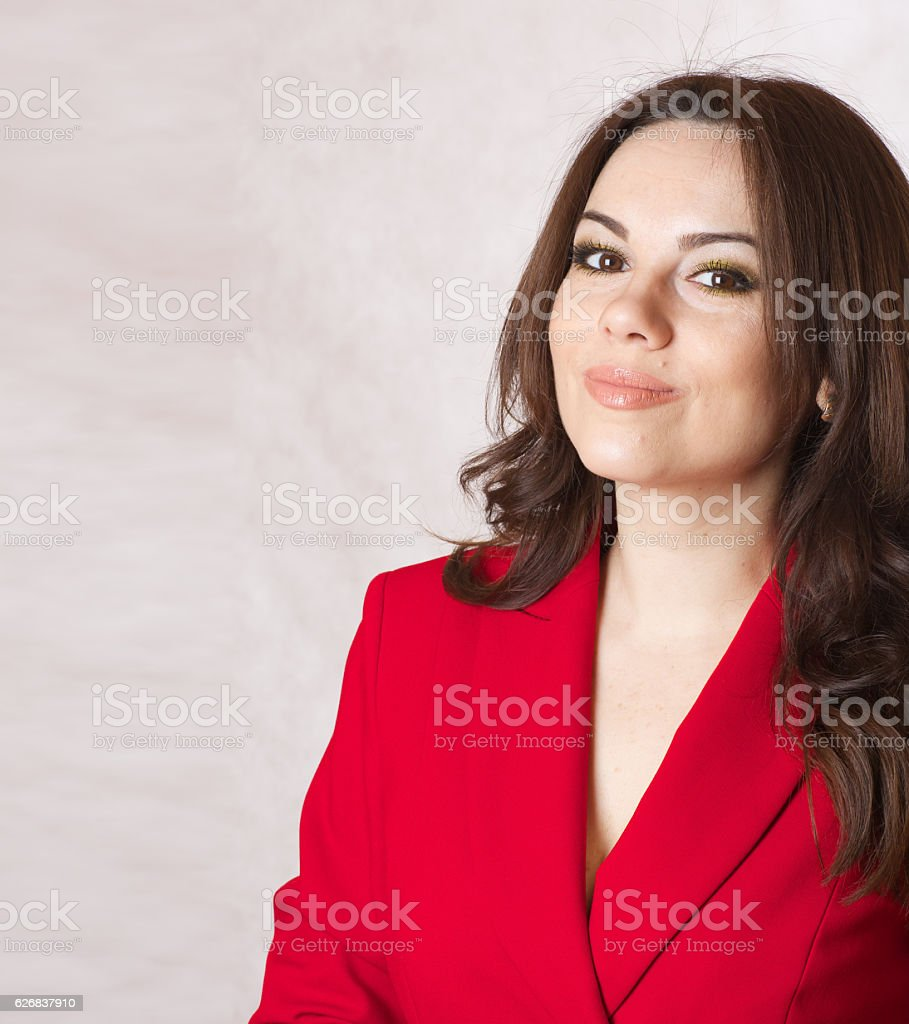 Young smiling woman in a red classical jacket. stock photo