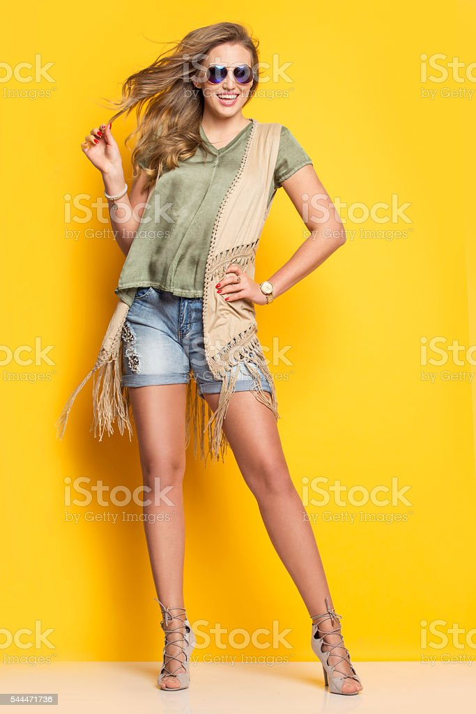 Young smiling woman in a summer dress stock photo