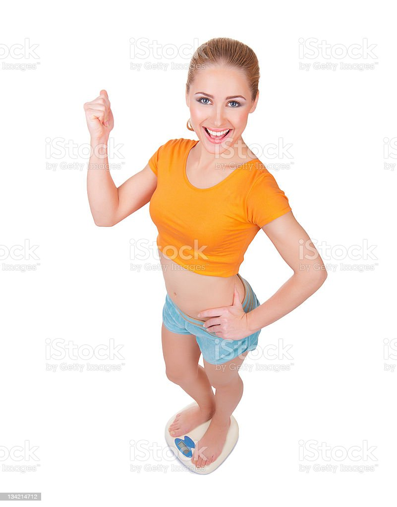 Young smiling woman on scales royalty-free stock photo