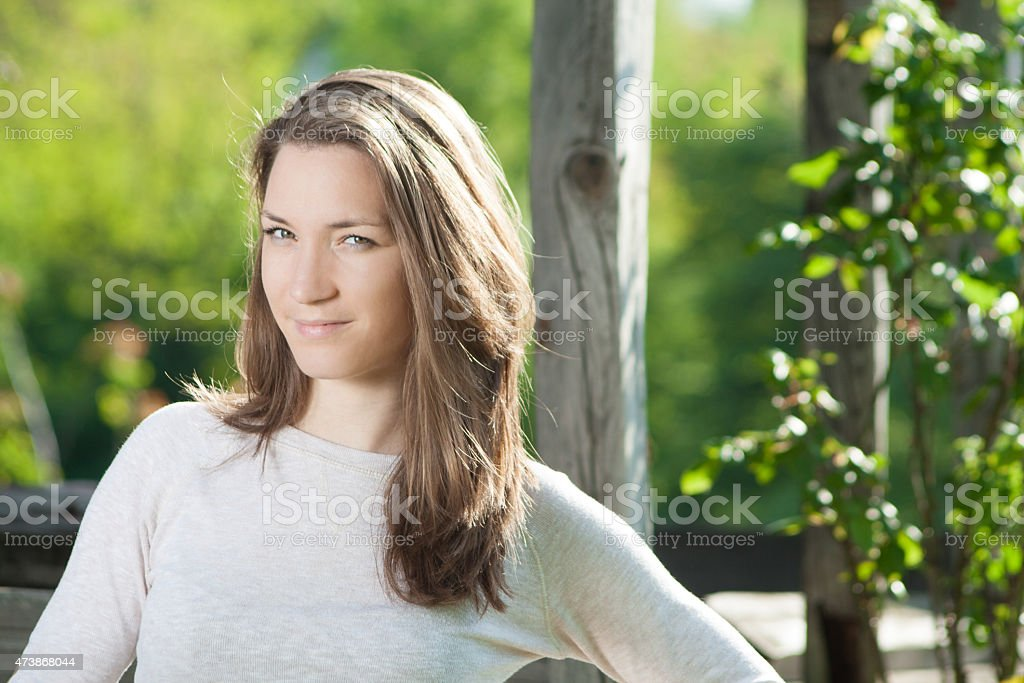 Young smiling woman portrait outdoors stock photo