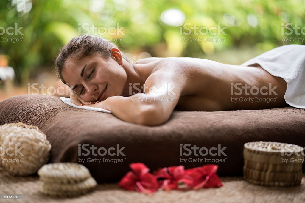 Young smiling woman waiting for her spa treatment. stock photo