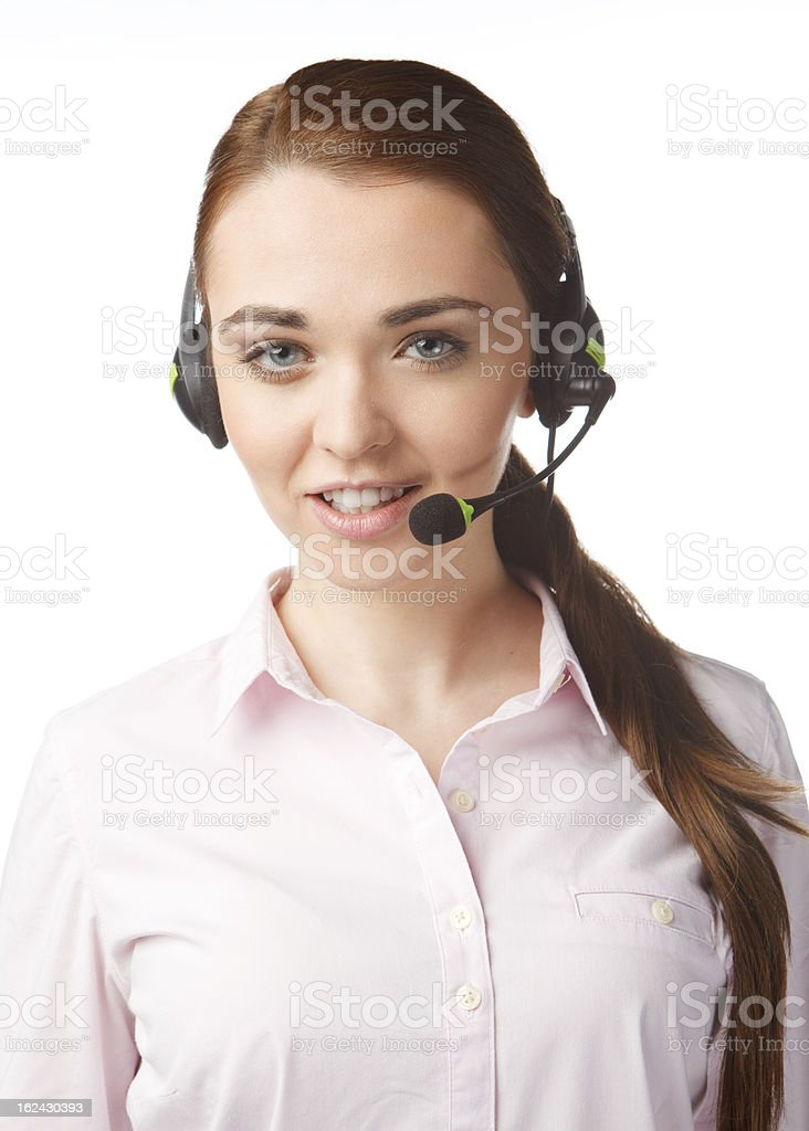 Young smiling woman with headphones in Call Centre royalty-free stock photo