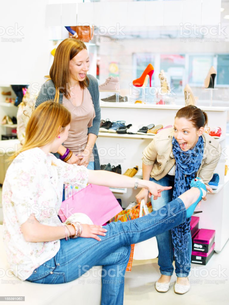 Young Smiling Women Shopping Shoes. royalty-free stock photo