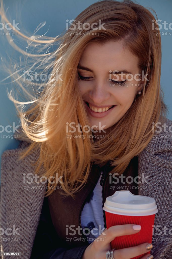 Young smille pretty woman in casual style with coffe cup royalty-free stock photo