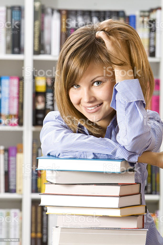 Young smilling woman sitting with books royalty-free stock photo