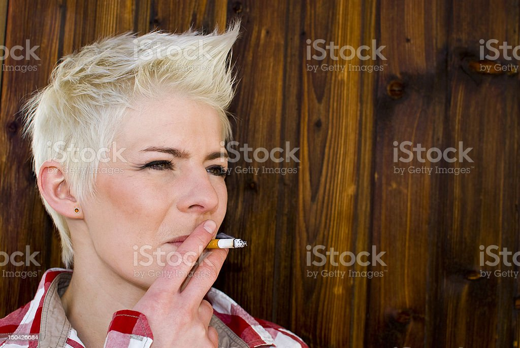 Young smoking girl does not think of the health stock photo