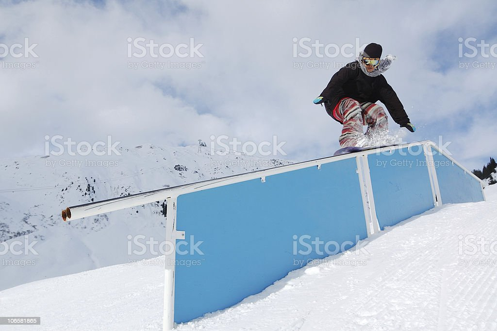young snowboarder  jibbing royalty-free stock photo