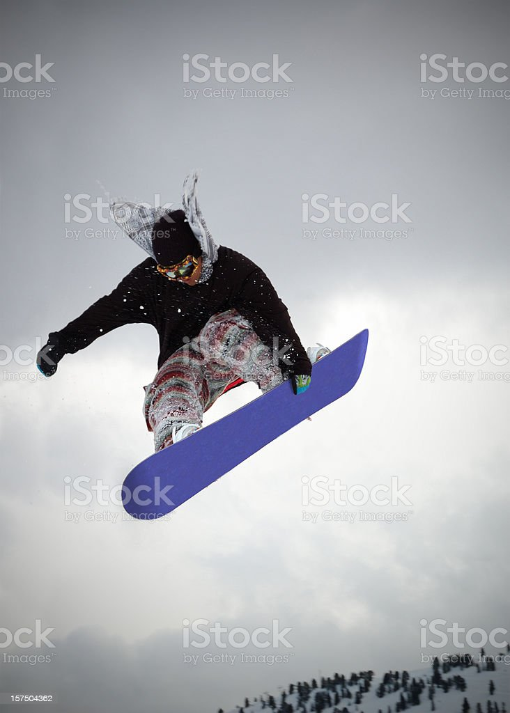 young snowboarder  jumping stock photo