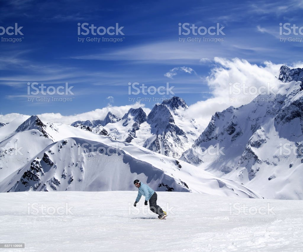 Young snowboarder on ski slope stock photo