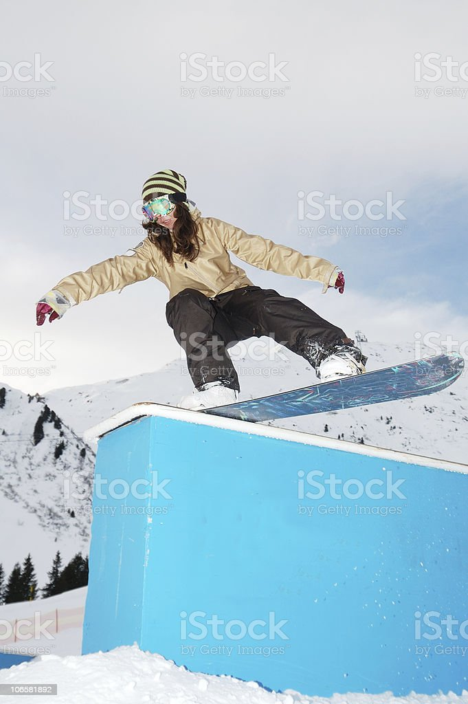 young snowboarder woman jibbing royalty-free stock photo