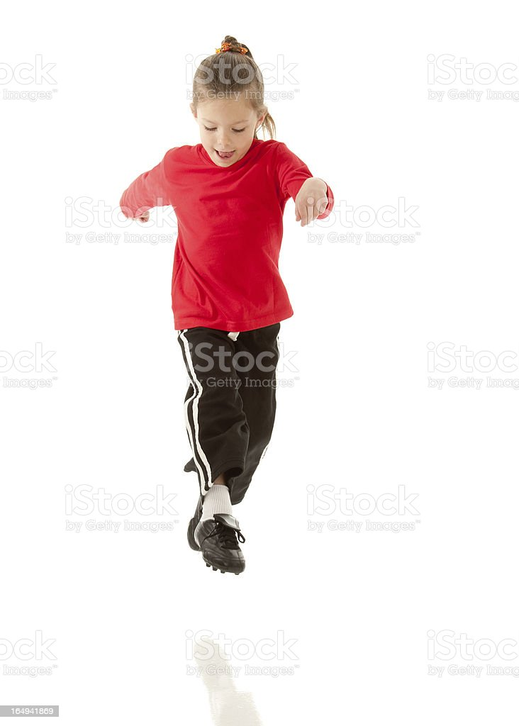 Young Soccer Player in Action (Studio Isolated with Reflection) stock photo