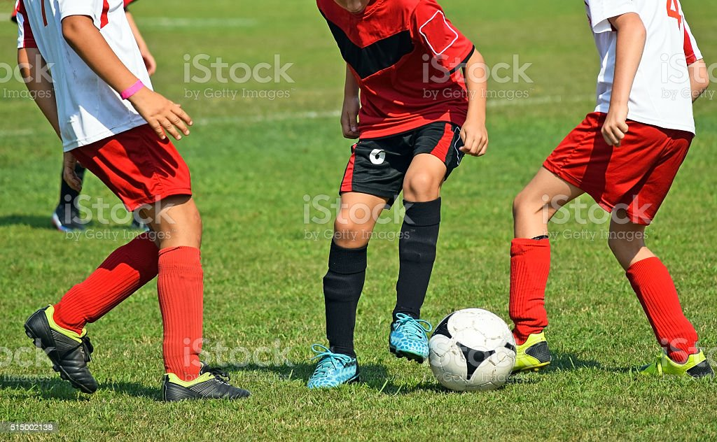 Young soccer players in action stock photo