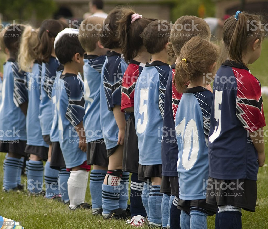 Young soccer players lining up for anthem royalty-free stock photo