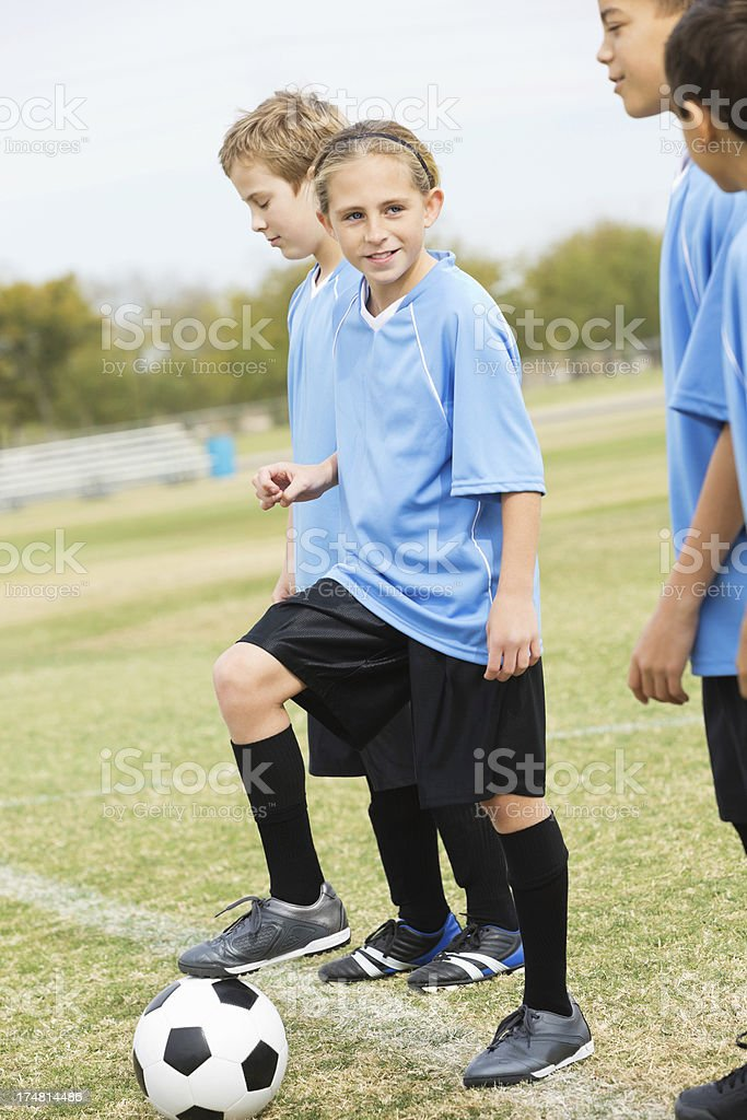 Young soccer players on sidelines of game royalty-free stock photo