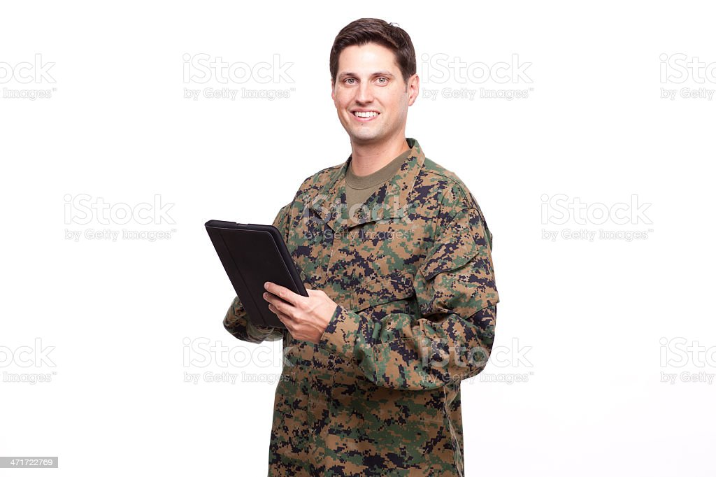 young soldier with a digital tablet royalty-free stock photo
