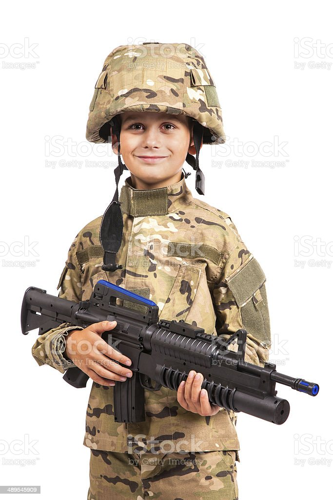 Young soldier with rifle stock photo