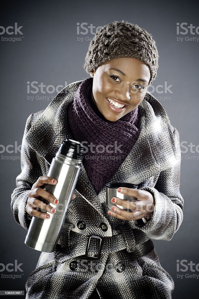 Young South African female pouring coffee royalty-free stock photo