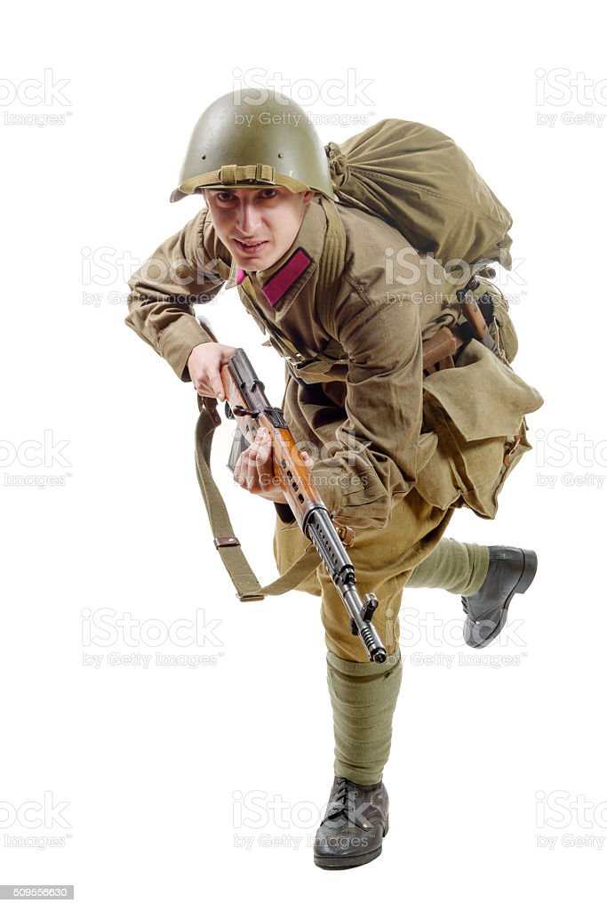 young Soviet soldier with  rifle on the white background stock photo