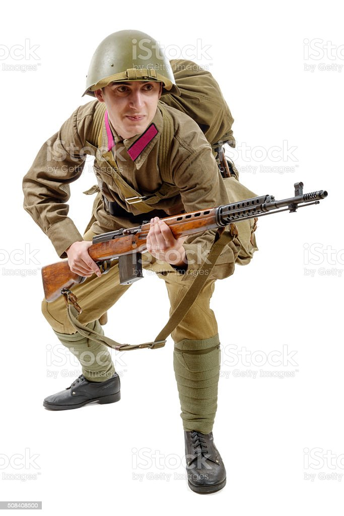 young Soviet soldier with SVT rifle on the white background stock photo