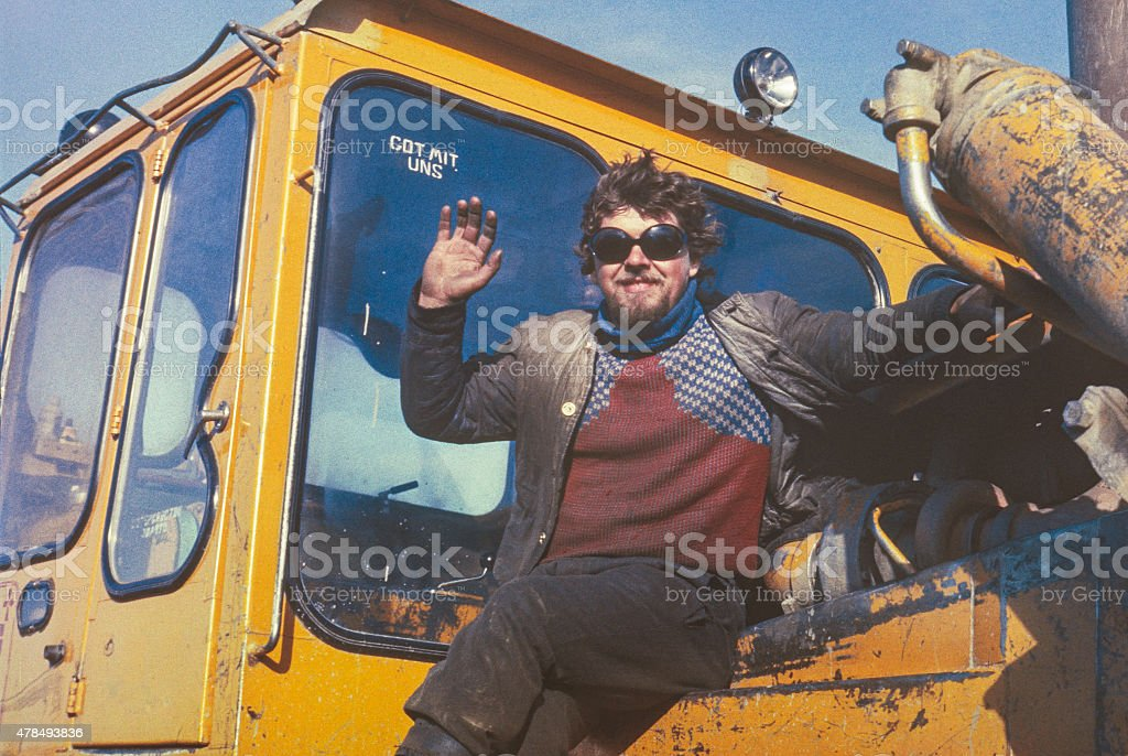 Young soviet tractor driver having short rest stock photo