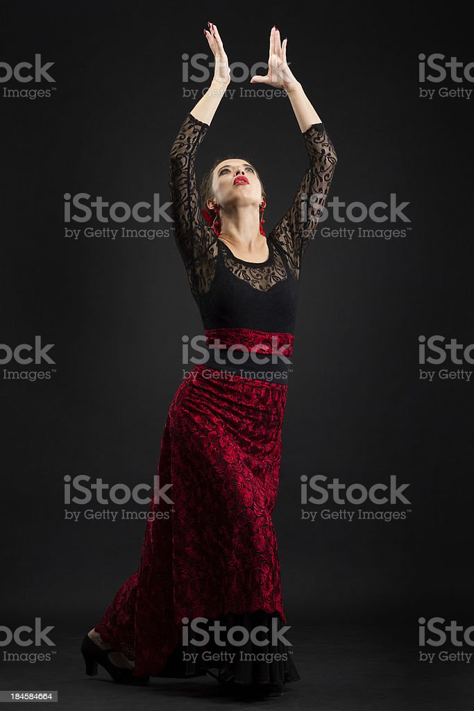 Young spanish woman dancing flamenco on black royalty-free stock photo