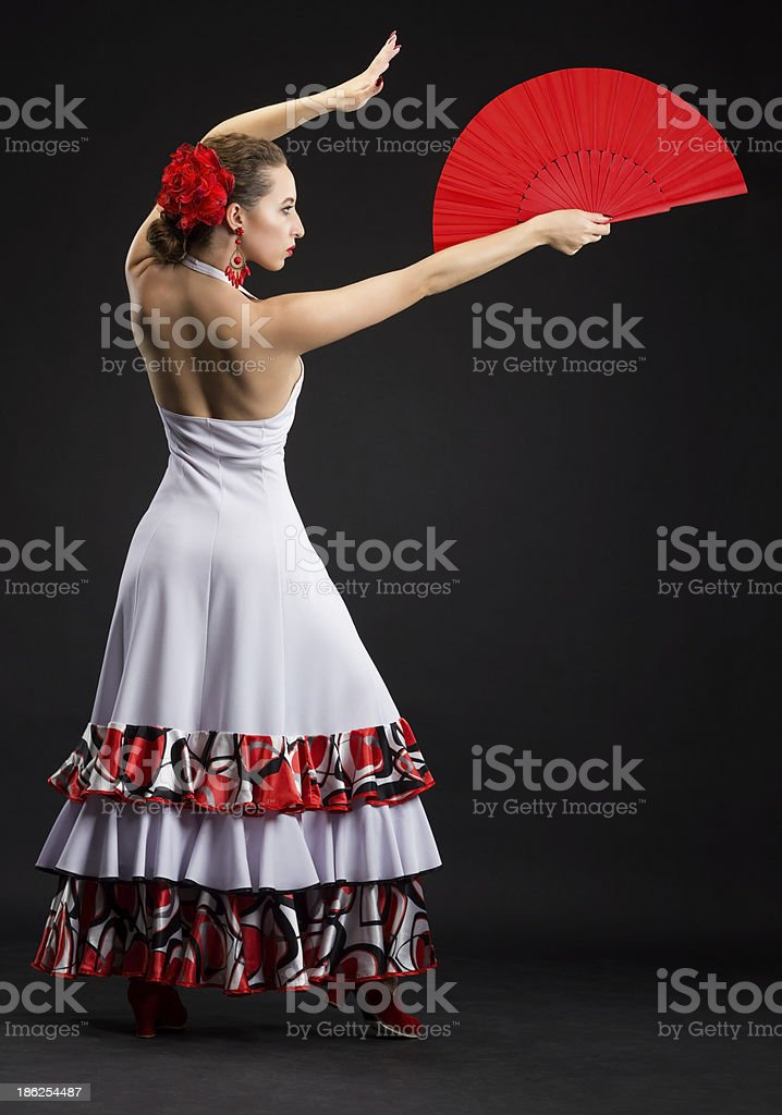 Young spanish woman dancing flamenco on black royalty-free stock photo