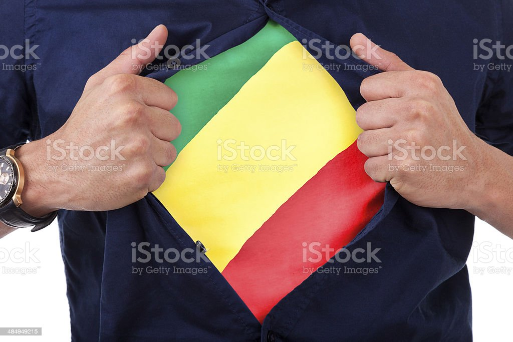 Young sport fan opening his shirt and showing his flag stock photo
