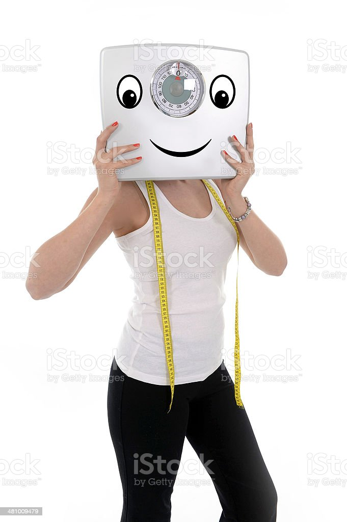 young sport woman holding bathroom weight happy face stock photo
