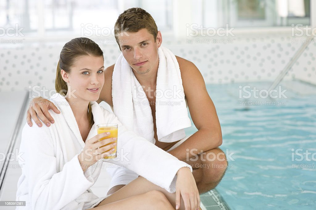 Young sportive couple relax at swimming pool royalty-free stock photo