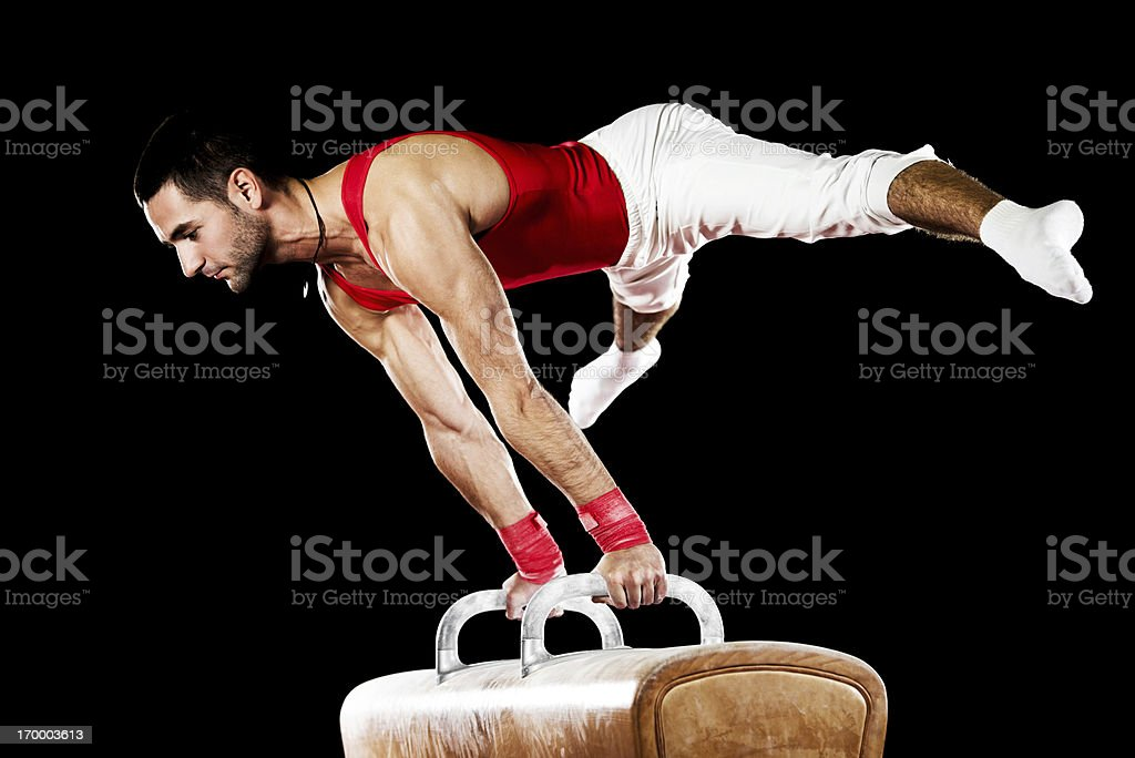 Young sportsman exercising on pommel horse. royalty-free stock photo