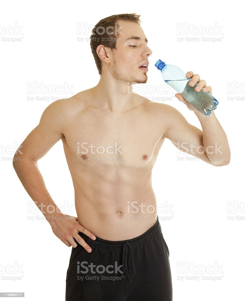 young sportsman with a bottle of clear liquid royalty-free stock photo