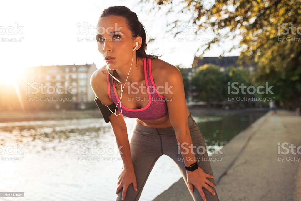 Young sportswoman resting after run stock photo