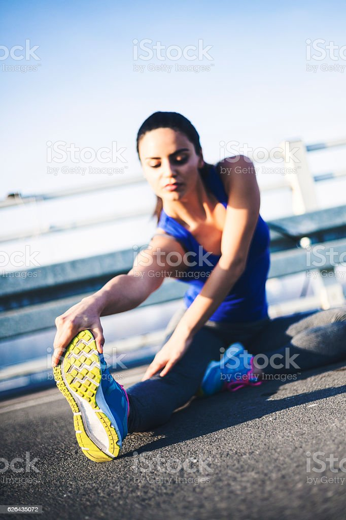 Young sportswoman stretching royalty-free stock photo