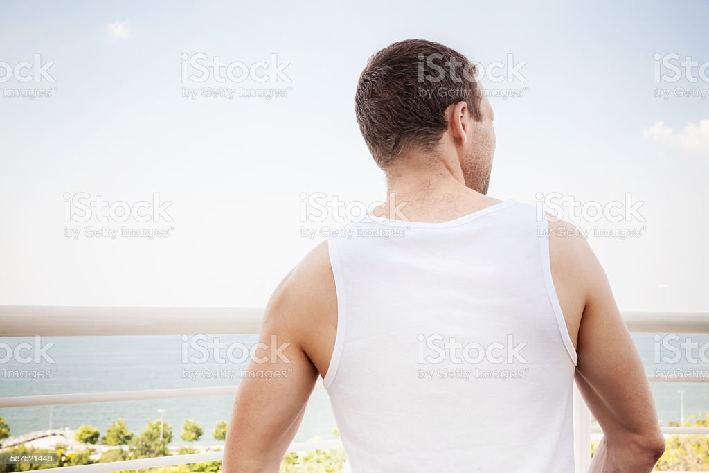 Young sporty Caucasian man in white stock photo