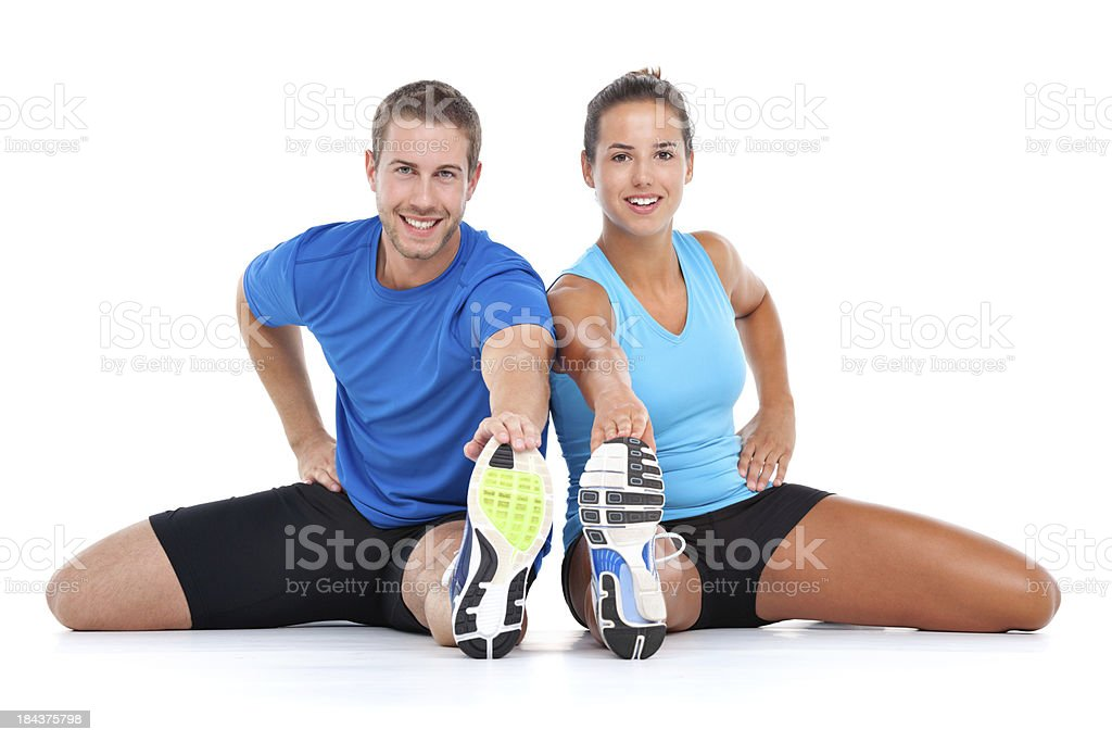 young sporty couple stretching together royalty-free stock photo