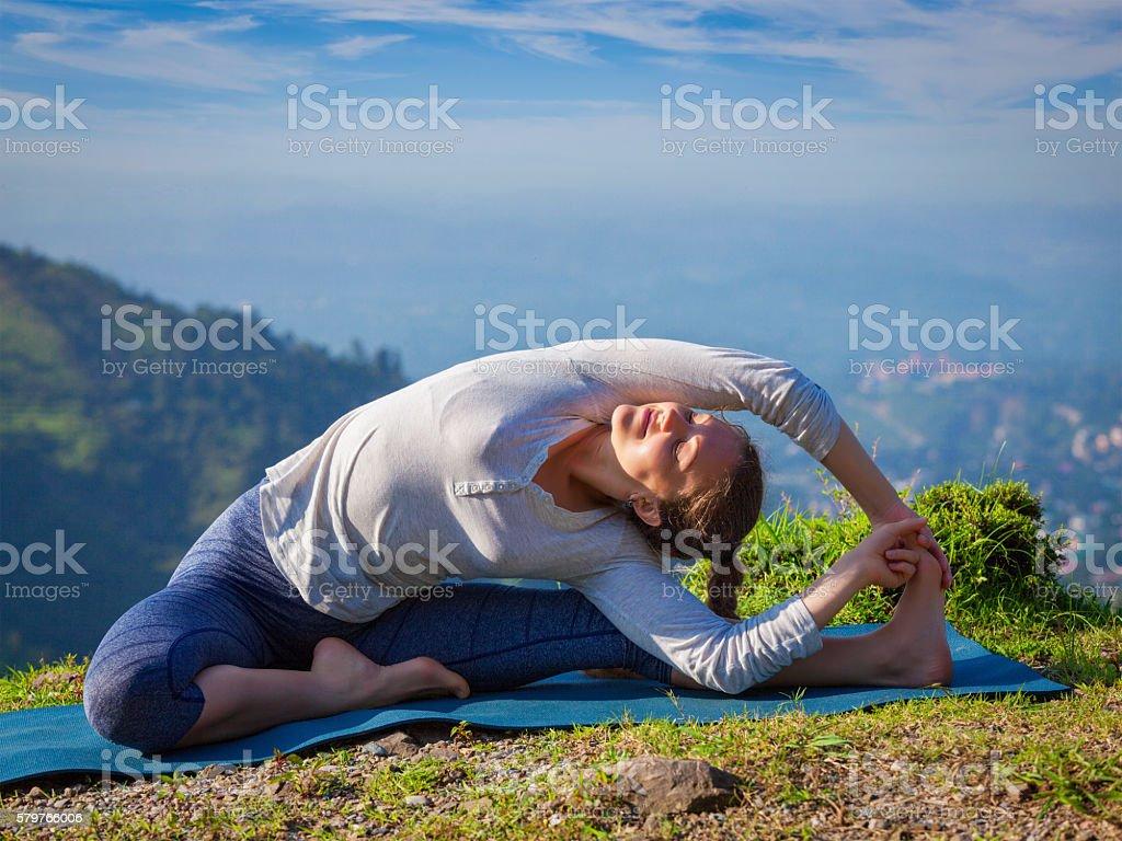 Young sporty fit woman doing Hatha Yoga asana stock photo
